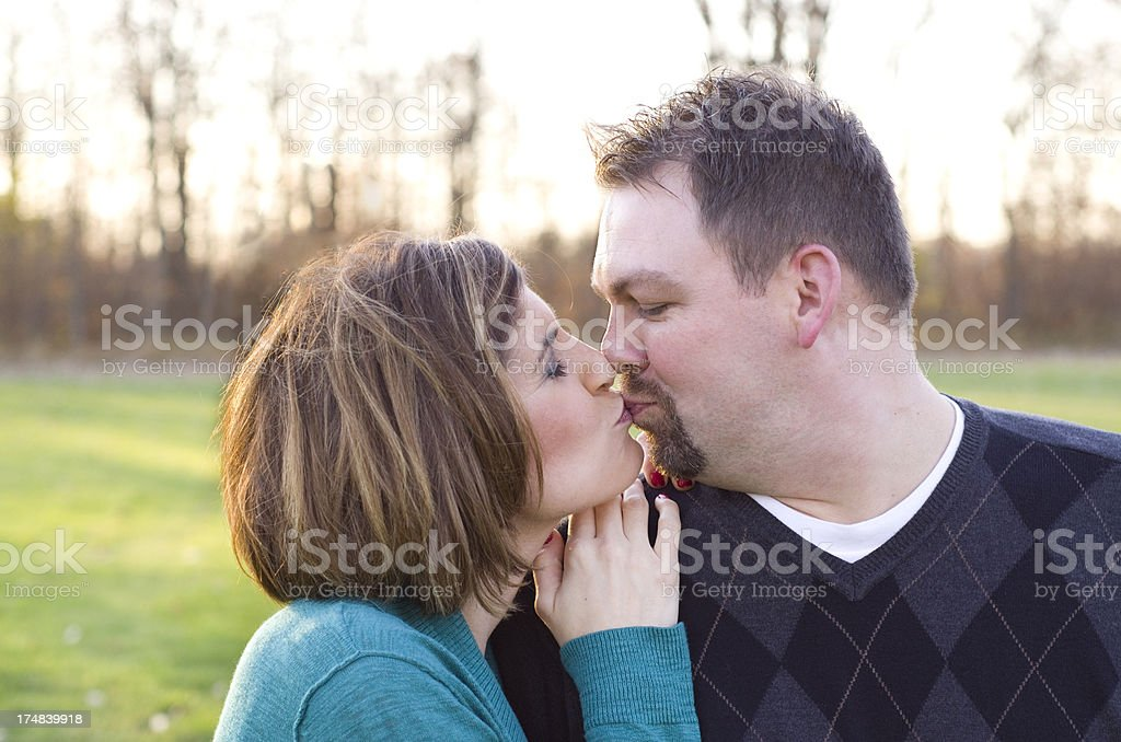 Kissing in the sunset royalty-free stock photo