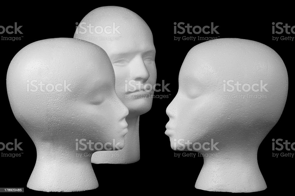 Kissing mannequin heads royalty-free stock photo