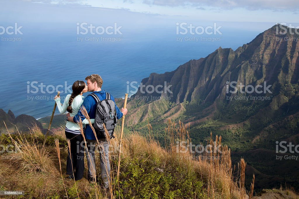 Kissing on a Mountain Top stock photo