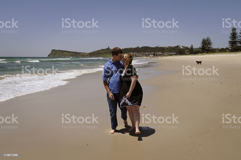 Kissing on the beach stock photo