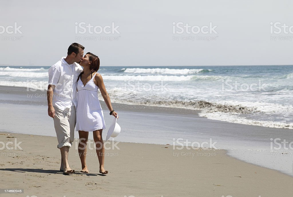 Kissing On The Beach royalty-free stock photo
