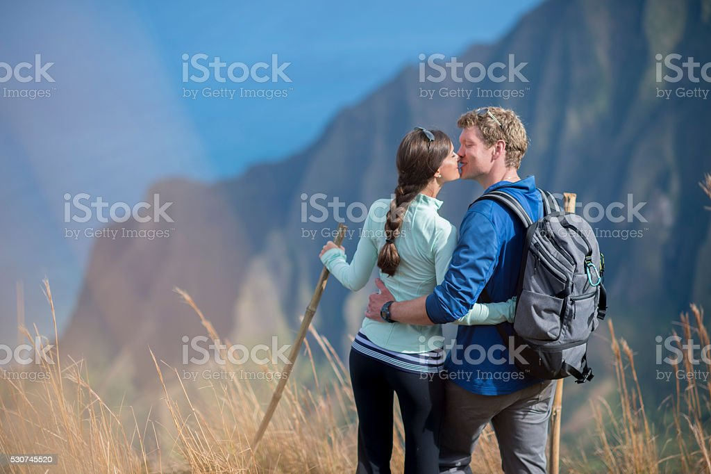 Kissing on Top of the Mountain stock photo
