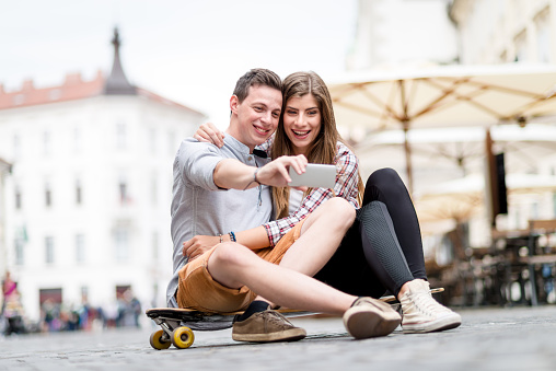 Image result for couples in bed with mobile