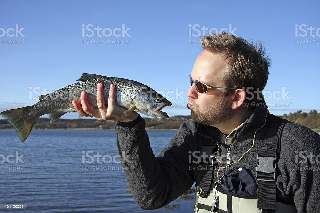 Kissing the trout stock photo