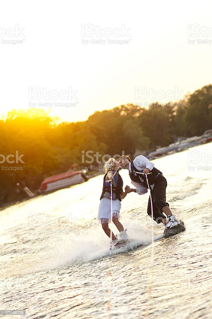 Kissing while waterskiing royalty-free stock photo