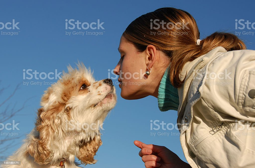 kissing woman and dog royalty-free stock photo