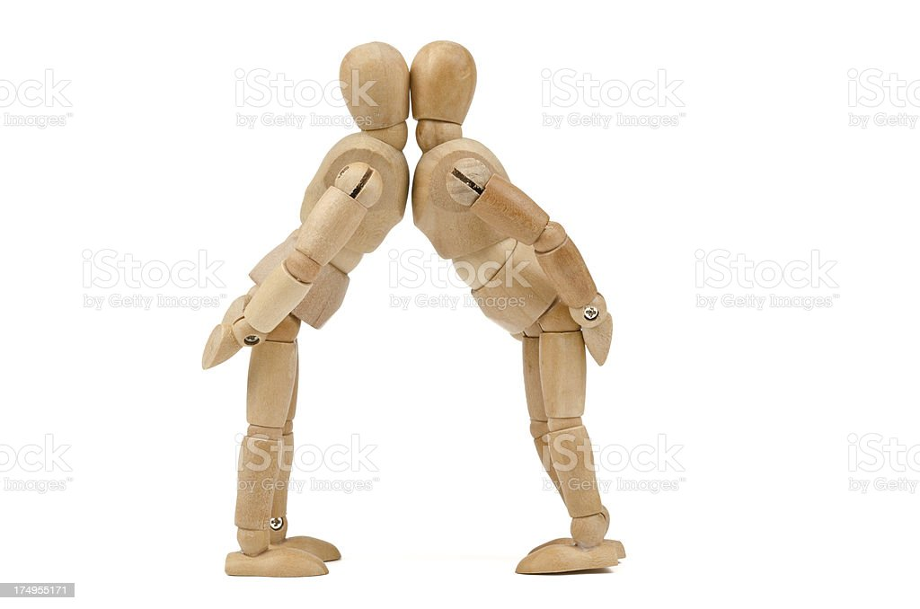 kissing wooden mannequins stock photo