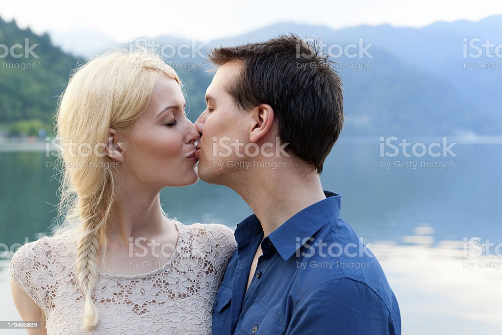 kissing young couple royalty-free stock photo