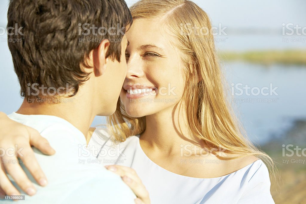 Kissing youths stock photo