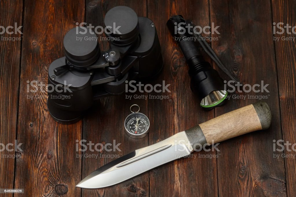 Kit of explorer or hunter on a wooden background stock photo