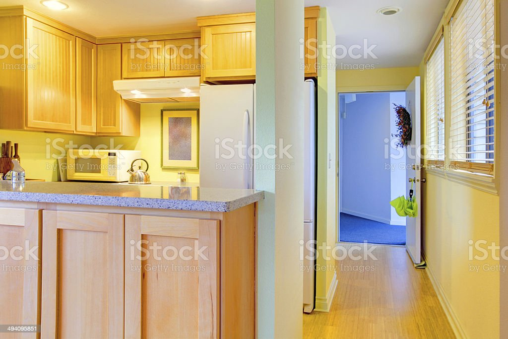 Kitchen and hallway with open door stock photo