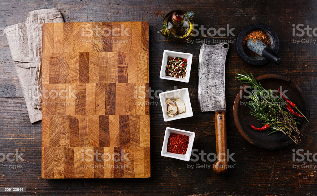 Kitchen board, seasoning, herbs and cleaver stock photo