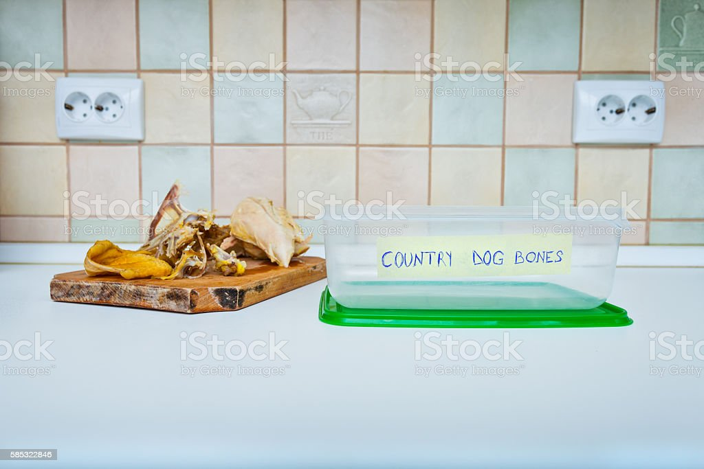 Kitchen bones container for dogs stock photo