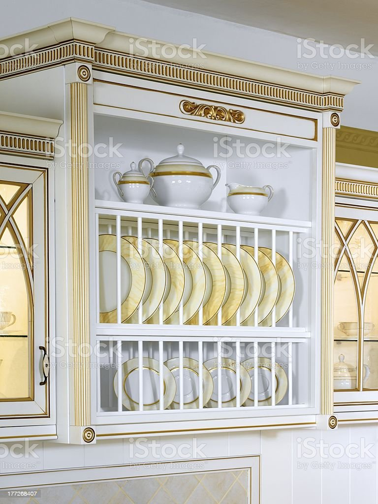 Kitchen case with beautiful ware royalty-free stock photo