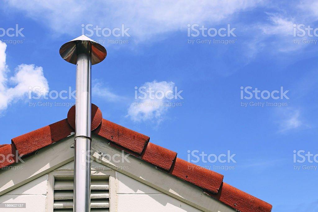 Kitchen chimney smoke and roof stock photo