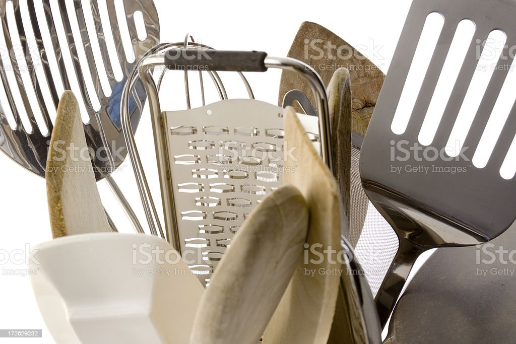 Kitchen Cooking Utensils, Wooden Spoons and Metal Equipment on White royalty-free stock photo