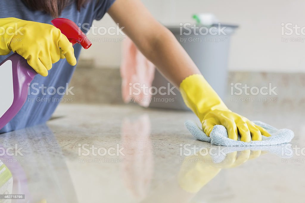 Kitchen counter being cleaned stock photo