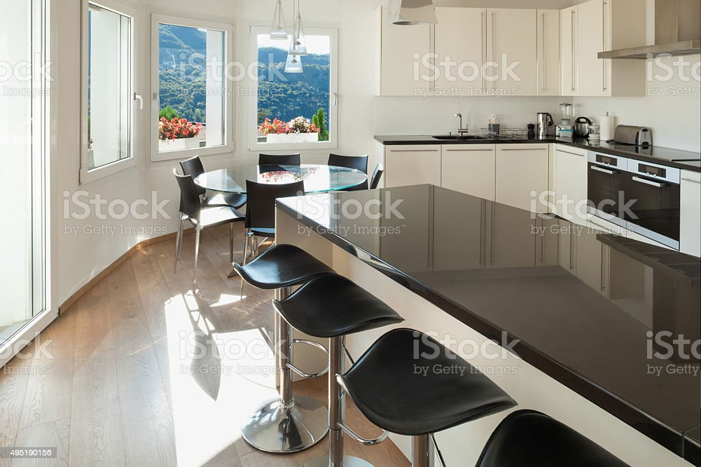 Kitchen, counter top with stools stock photo