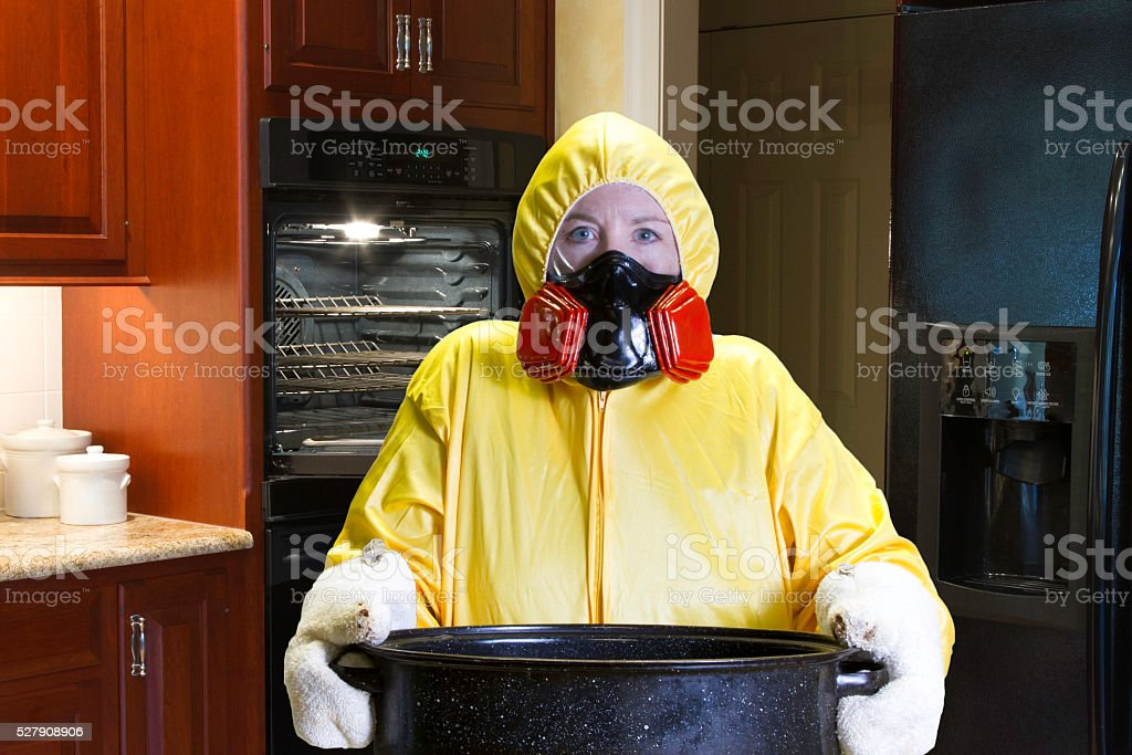 Kitchen disaster in kitchen with HazMat Suit stock photo