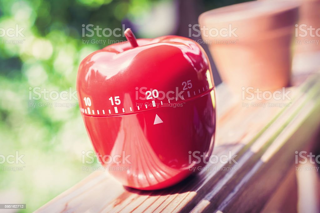 Kitchen Egg Timer in Apple Shape On Handrail stock photo