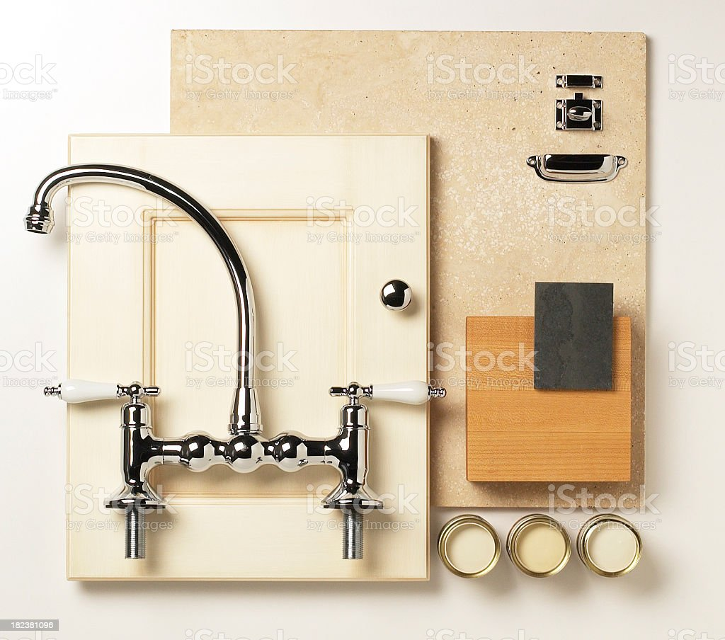 Kitchen faucet resting on a cream colored cupboard door  royalty-free stock photo