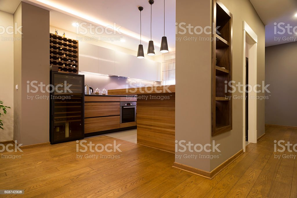 Kitchen interior in spacious apartment stock photo