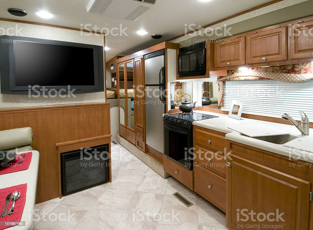 RV kitchen interior photo with cream floor stock photo