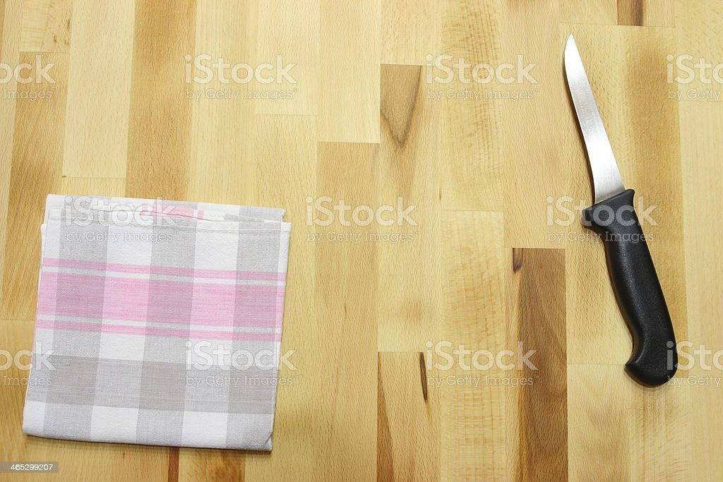 Kitchen knife and towel royalty-free stock photo