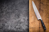 Kitchen knife on concrete or wooden board