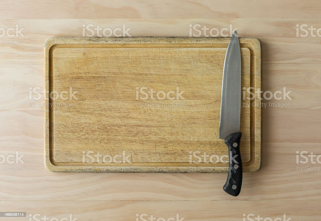 kitchen knife on cutting board stock photo