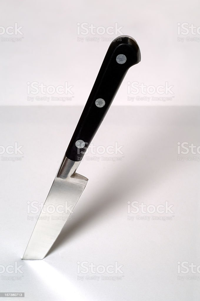 Kitchen Knife sticking in table royalty-free stock photo