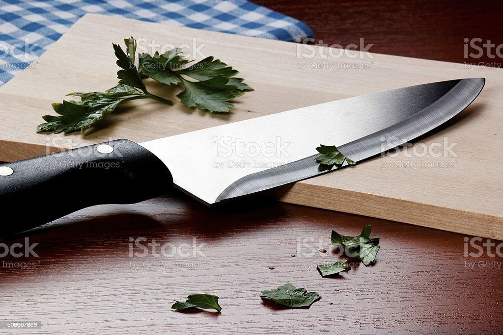 Kitchen Knive on cutting board stock photo