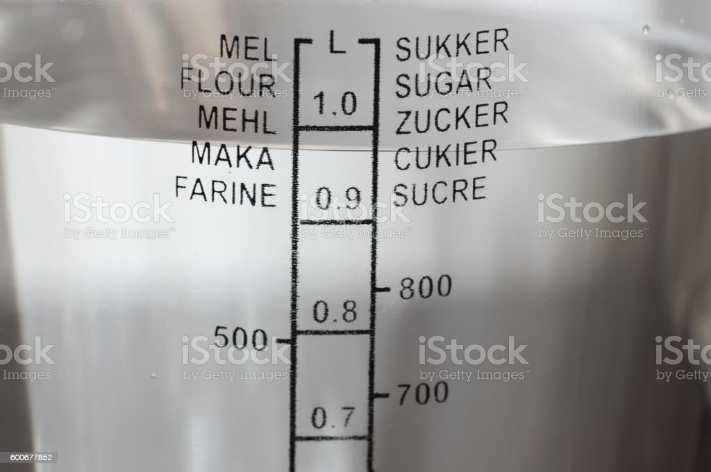kitchen measuring cup with water stock photo