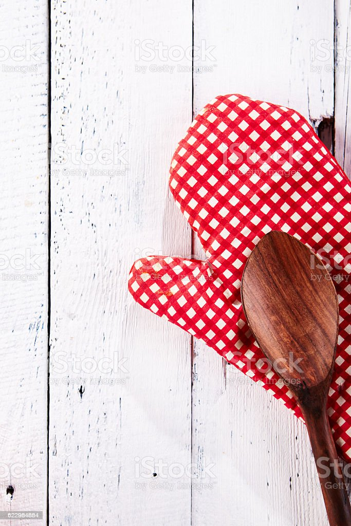 Kitchen Mitts and Wooden Spoon Top View stock photo