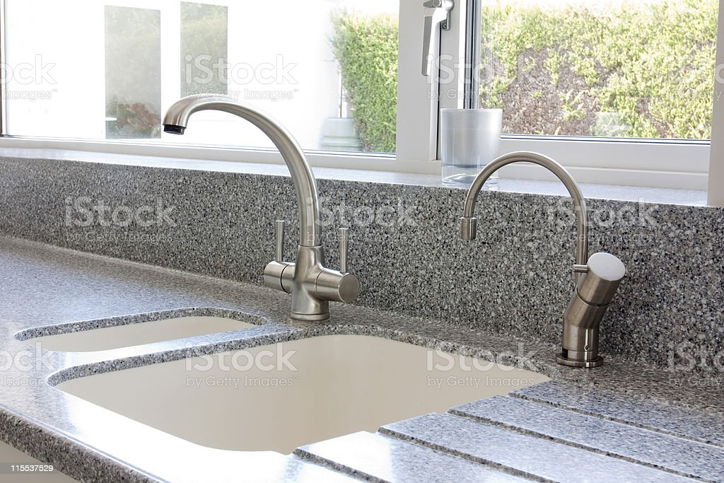 Modern kitchen granite worktop and ceramic sink with mixer tap