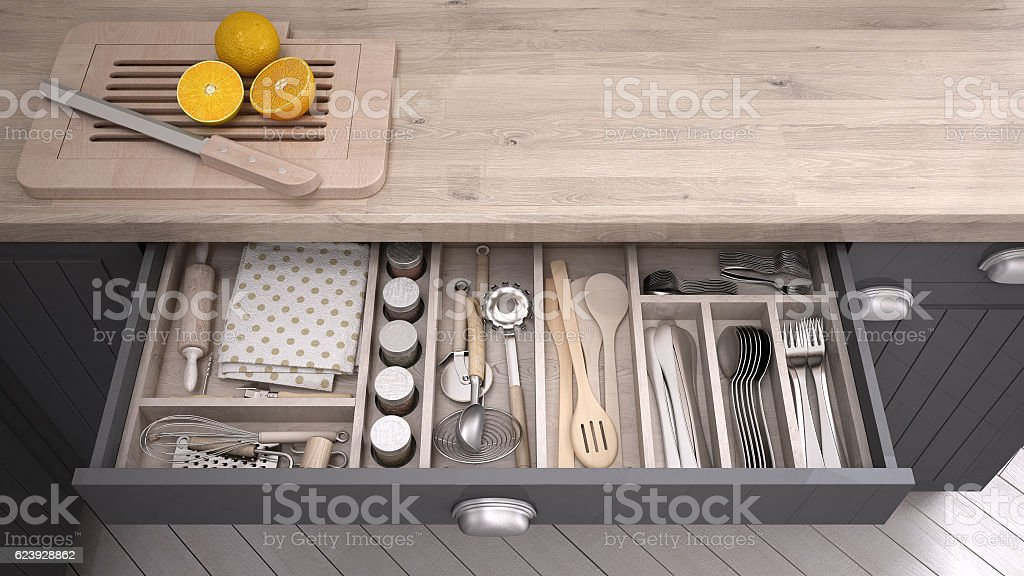 Kitchen opened drawer full of kitchenware stock photo