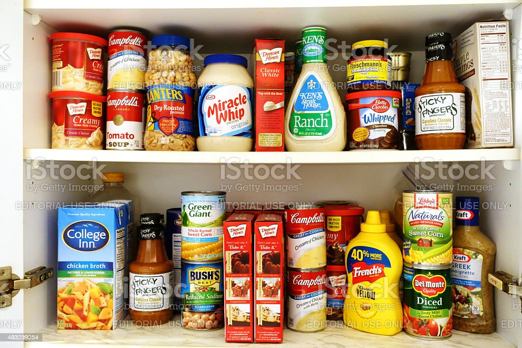 Kitchen pantry shelves filled with groceries stock photo