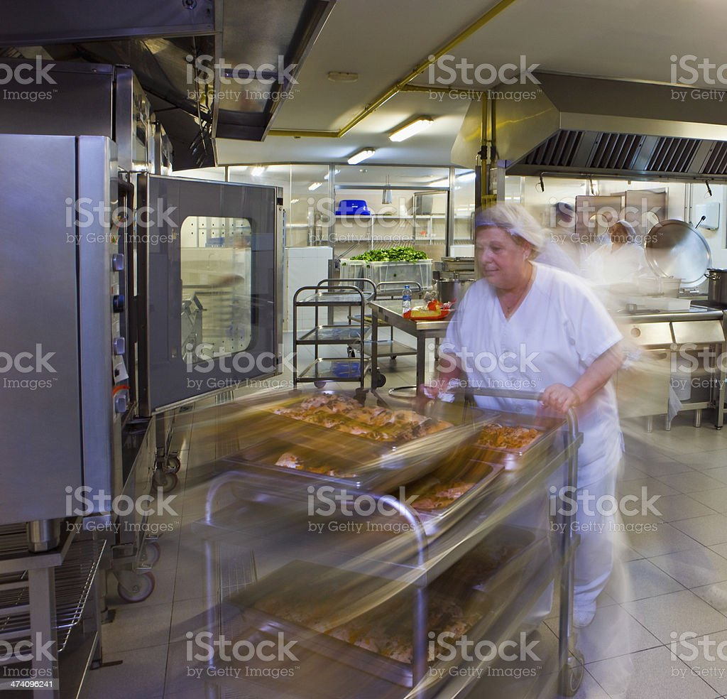 Kitchen Porter Pushes A Trolley Of Pastries stock photo