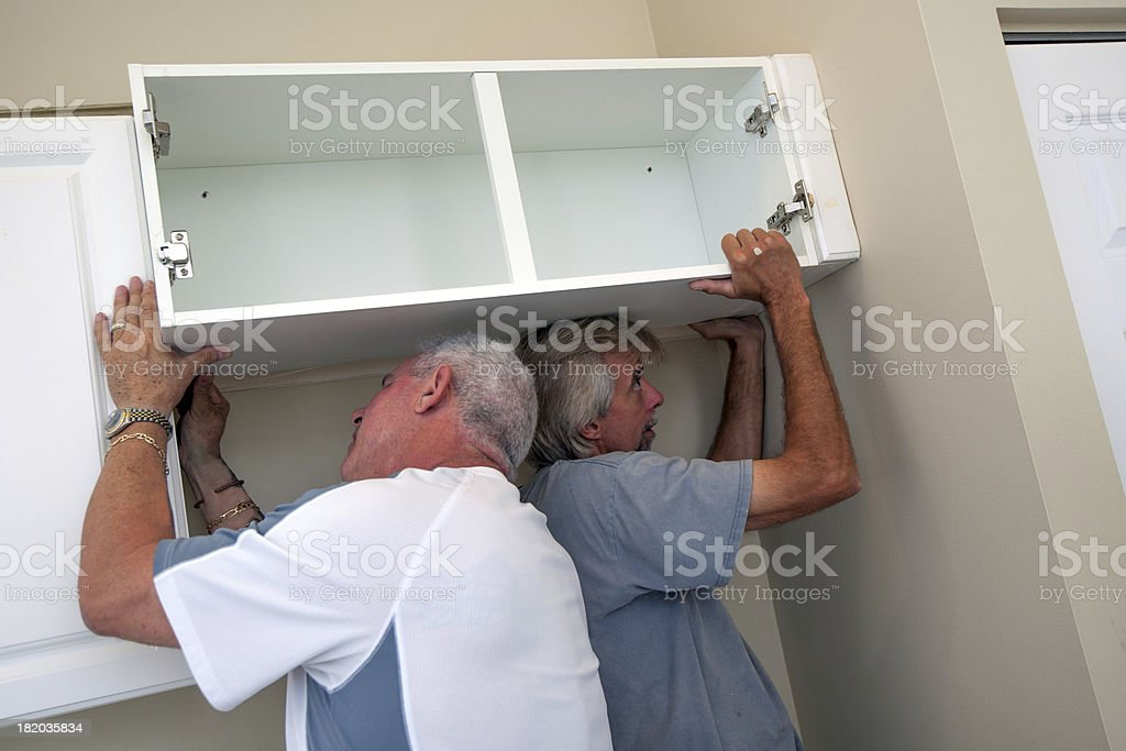 Kitchen remodeling cabinet installation stock photo