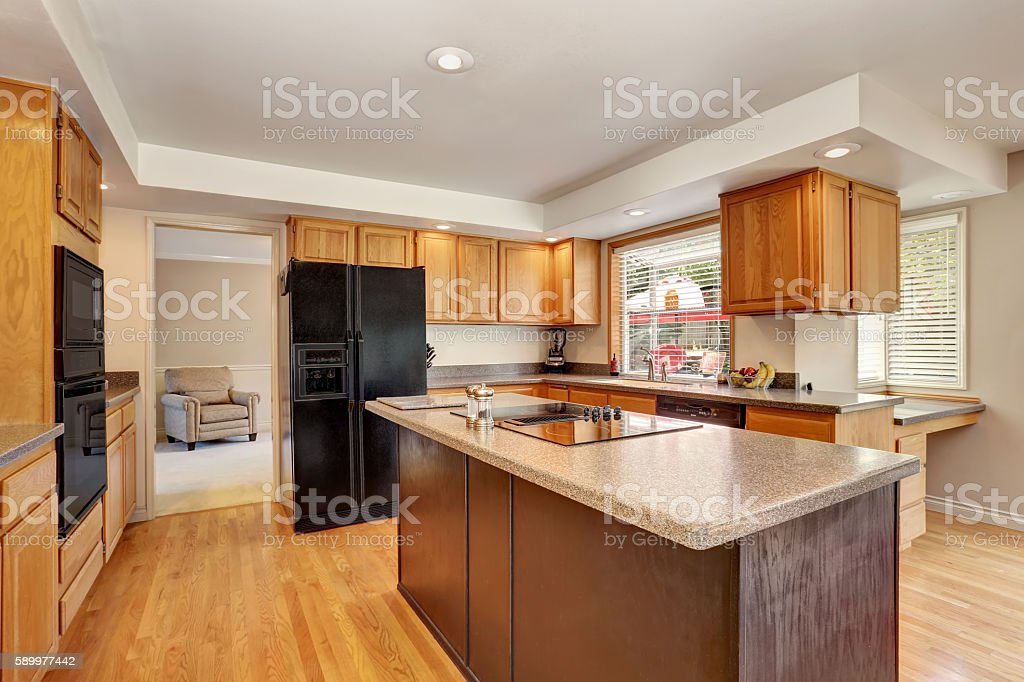 Kitchen room interior with with granite counter top and island....