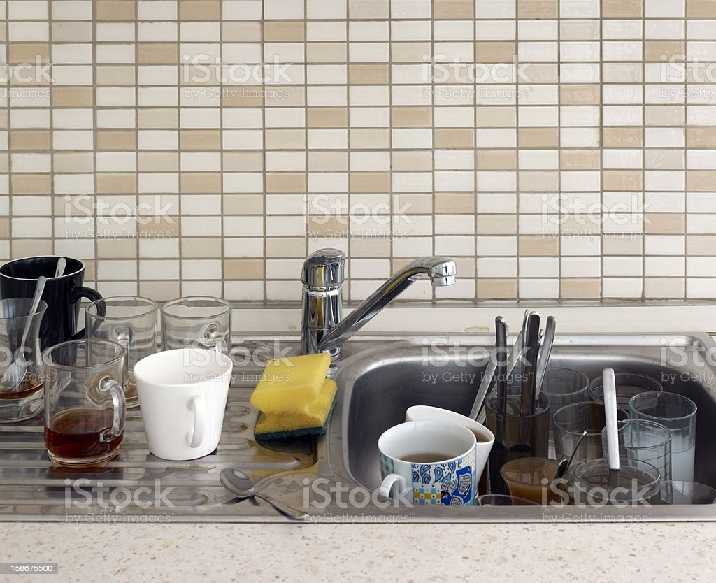 Kitchen sink dirty dishes royalty-free stock photo