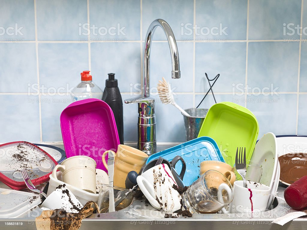 Kitchen sink full of dirty dishes  stock photo