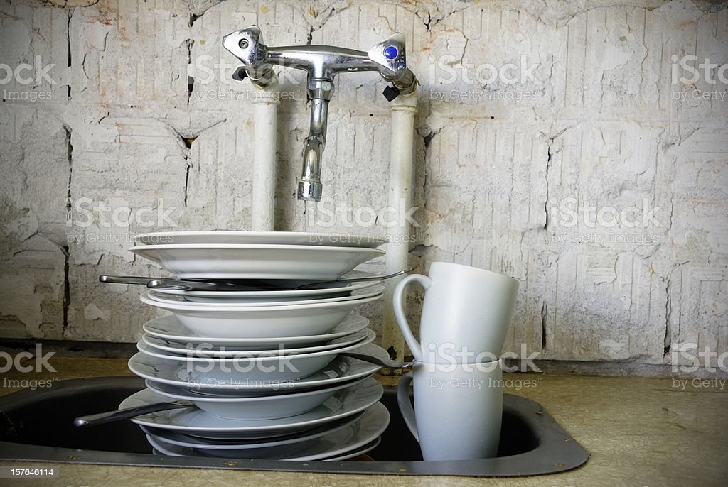Kitchen sink with dirty dishes stock photo