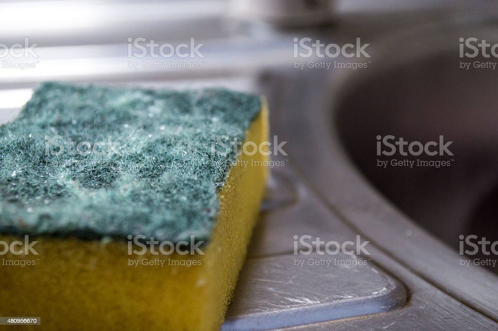 Kitchen Sponge/Scouring Pad Near a Sink stock photo