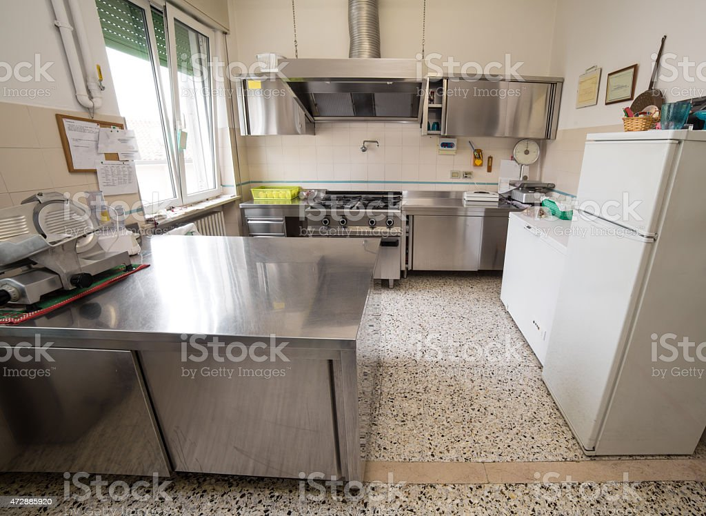 kitchen stainless steel industry with large gas stove stock photo