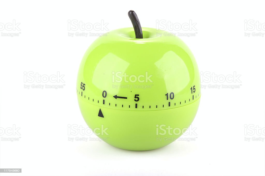 kitchen timer in the form of green apple stock photo