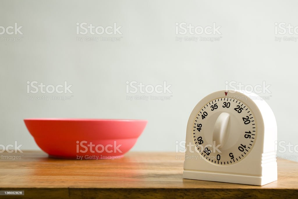 Kitchen timer on counter royalty-free stock photo