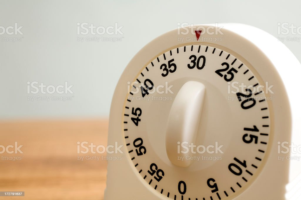 Kitchen timer on counter stock photo