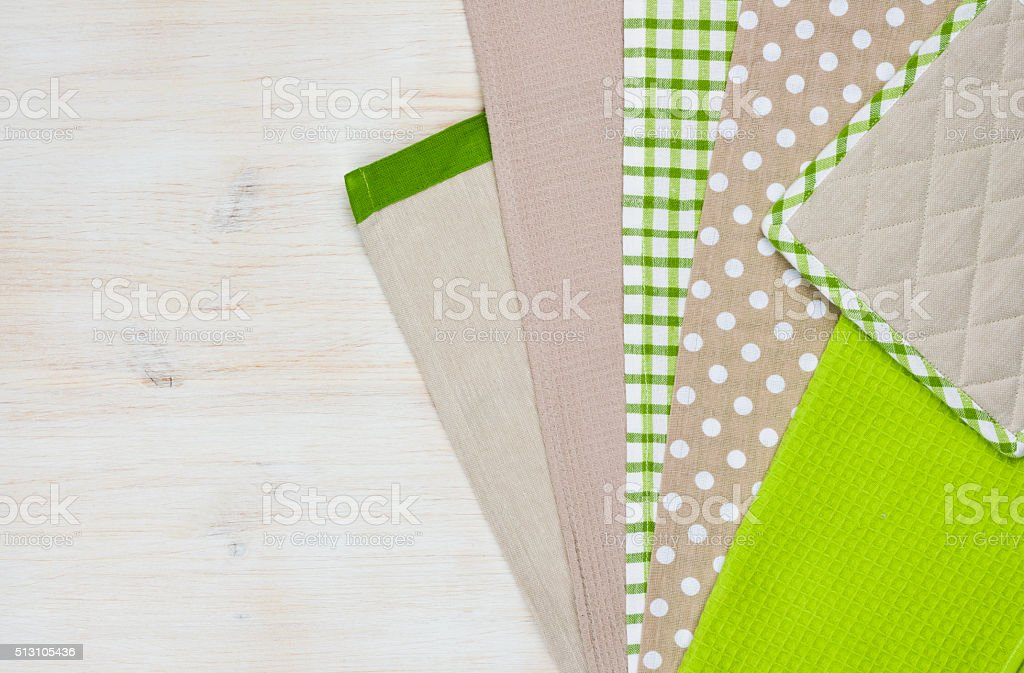 Kitchen towels on wooden background with right side copy space stock photo