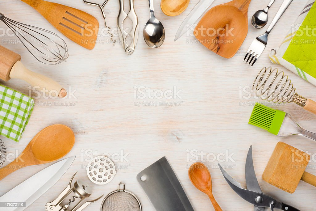 Kitchen utensils and cutlery background with copy space in center stock photo